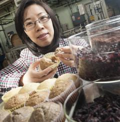 Dr. Yanyun Zhao holds grape pomace muffin