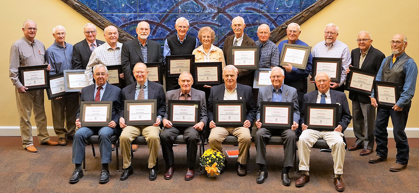From top row, left to right: Gary Simon, Gale Gingrich, Jim Heater, Jack Long, Carl Schreck, Roger Fletcher, Carol Roy, Martin Vavra, Clint Jacks, Lynn Trupp, John Buckhouse, Thomas Savage, Bob Klinger From bottom row, left to right: Richard Smiley, Logan