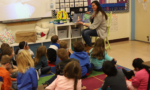 Ashley Devery reading to students