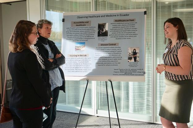 Anna Breen (right), undergraduate in Bioresource Research, explains her internship in Ecuador to Alyssa Nelson (far left) (undergraduate in Animal Sciences) and Liz Larew (donor).