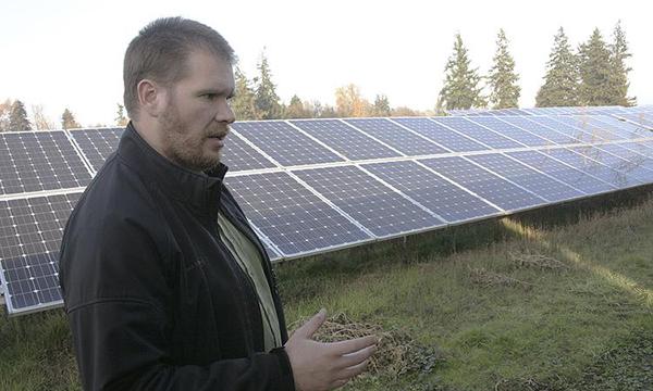 Chad Higgins by a Solar Array
