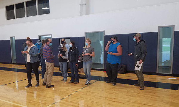 Group of students learning to use a drone