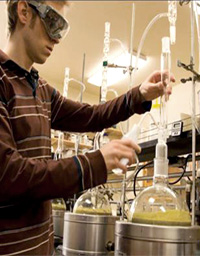 Graduate student Daniel Sharp conducting lab experiment