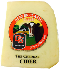 Wedge of Cider Cheddar variety of Beaver Classic Cheese