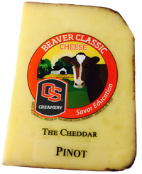 Wedge of Pinot Noir Cheddar variety of Beaver Classic Cheese
