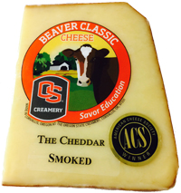 Wedge of Smoked Cheddar variety of Beaver Classic Cheese