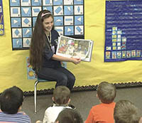 Yamhill County 4-H Ambassador reads to childresn