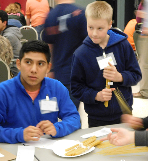 OSU student mentor, Juan Santiago helps students at the Challenge