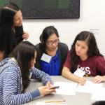 Grad student Kimi Grzyb works with students to show how to make biofilms