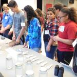 table with supplies and student making bioplastics