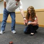 Teachers learn how to operate a small drone.