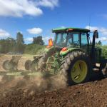 6120E tractor plowing