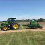 6120E Tractor with no-till drill