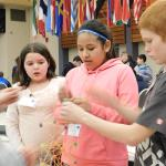 Middle school students building structures at Challenge event