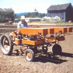 '47 G Tractor Spreading Fertilizer
