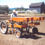 '47 G Tractor Spreading Fertilizer