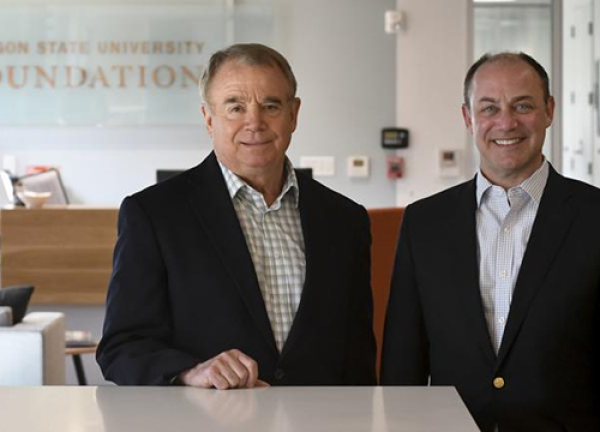 Oregon State University Foundation President and CEO Mike Goodwin, left, and Executive Vice President Shawn Scoville pose at the foundation's office in Corvallis. Goodwin is retiring Jan. 3, and Scoville has been announced as his successor.