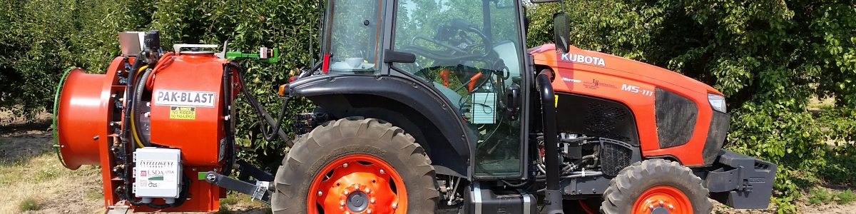 tractor with small sprayer attached to rear. sprayer has LiDAR sensor that detects plants in area