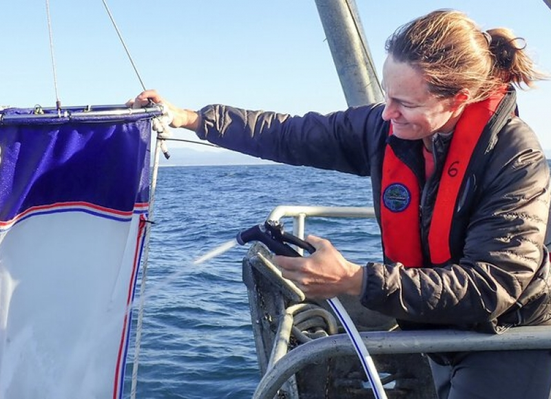 Jennifer Fisher at sea handling a bongo net used for zooplankton sampling, aboard the Oregon State University research vessel... (Nancy Steinberg / Oregon State U )