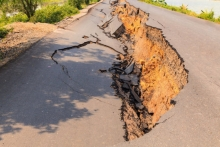 Cracked road due to shifting soil
